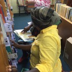 ECD Practitoners select books in the library