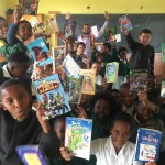 Grade 5 children show their favourite books