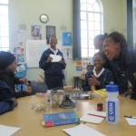 Grade 6 Book club plays a literacy game in the library