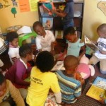 Children reading in a local ECD Centre