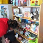 Helping to set up a book area in an ECD Centre