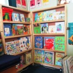 A corner library that works with minimal space, and yet is inviting to children