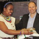 Our Chairperson, Greg Webb, congratulates a staff member on her long service at ITEC